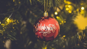 An ornament is seen on a Christmas tree in this stock photo. (Nubia Navarro/Pexels)
