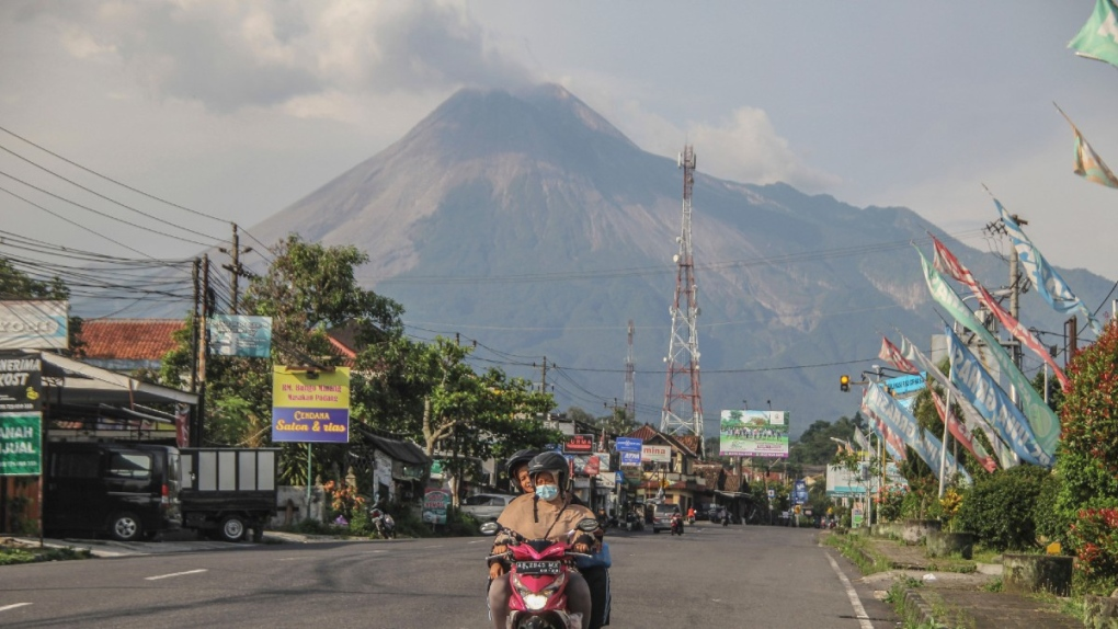 Mount Merapi looms in the background