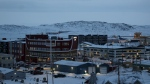 Downtown Iqaluit, Nunavut, is shown after 2 p.m. sunset on Tuesday, Nov. 24, 2020. THE CANADIAN PRESS/Emma Tranter