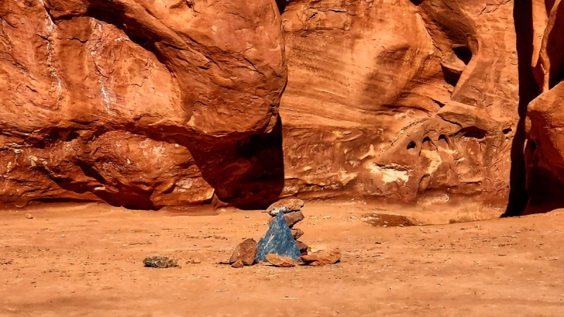 Rocks mark the location where a metal monolith once stood in the ground in a remote area of red rock in Spanish Valley, Utah south of Moab near Canyonlands National Park, on Nov. 28, 2020. (Kelsea Dockham / Canyon State Overland via AP)