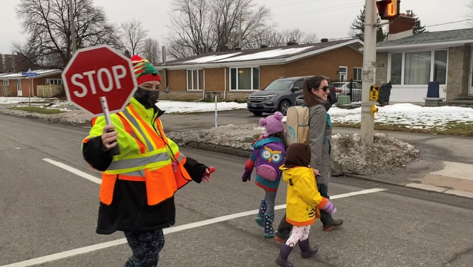 Crossing guard Eleanor Murnaghan is ensuring a safe crossing for students and parents heading to school. Ottawa, ON. Nov. 30, 2020. (Tyler Fleming / CTV News)