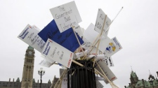 Discarded placards overflow from a garbage bin on Parliament Hill following a demonstration in support of Nortel pensioners on Parliament Hill in Ottawa, Wednesday October 21, 2009. (THE CANADIAN PRESS/Adrian Wyld)