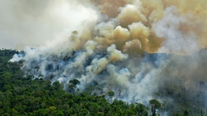 Aerial view of a burning area of Amazon rainforest reserve, south of Novo Progresso in Para state, Brazil, on Aug. 16, 2020. (AFP)