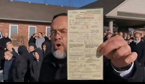 Pastor Henry Hildebrant shows off his ticket to his congregants on Nov. 7, 2020 (Source Facebook).