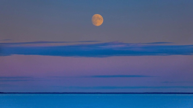 Moonrise over Clearwater Lake. Photo by Doug Lauvstad.