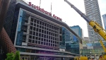 "Workers prepare to install a new video board and signage outside of the Scotiabank Arena in Toronto on Wednesday, July 31, 2019. While the Maple Leafs and Raptors gear up for next season, Scotiabank Arena is getting a multimillion-dollar facelift. MLSE president and CEO Michael Friisdahl calls it a ""reimagination"" of the venue that opened in February 1999. THE CANADIAN PRESS/Neil Davidson"