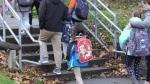 Surrey school reopens after outbreak