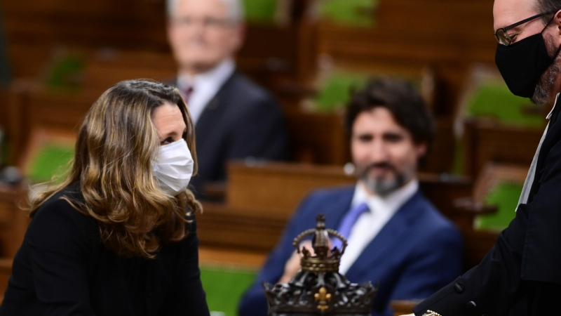 Minister of Finance Chrystia Freeland hands over the 2020 fiscal update in the House of Commons on Parliament Hill in Ottawa on Monday, Nov. 30, 2020. THE CANADIAN PRESS/Sean Kilpatrick