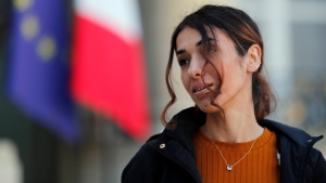 Nadia Murad, a Yazidi who escaped the Islamic State and a co-recipient of this year's Nobel Peace Prize, walks out after her meting with French president Emmanuel Macron at the Elysee Palace, in Paris, Thursday, Oct. 25, 2018. (AP Photo/Francois Mori)