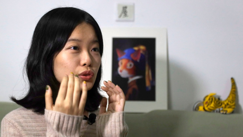 In this Jan. 16, 2019, photo, screenwriter Zhou Xiaoxuan speaks during an interview with the Associated Press at her home in Beijing, China, detailing her involvement in China's #MeToo movement. (AP Photo/Ng Han Guan)