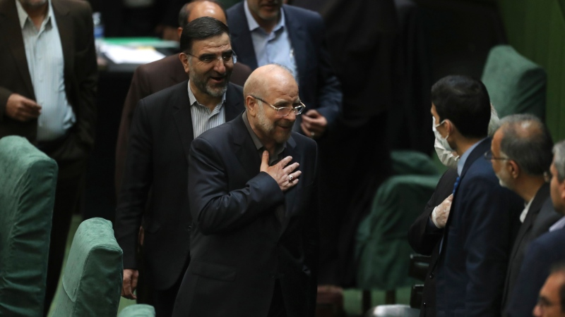 Mohammad Bagher Qalibaf, center, greets lawmakers after being elected as speaker of the parliament, in Tehran, Iran, Thursday, May 28, 2020. (AP Photo/Vahid Salemi)