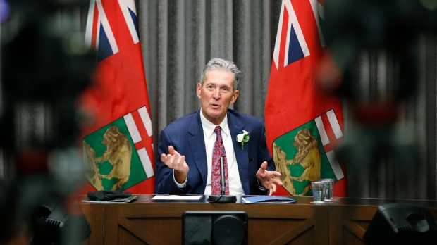 Manitoba premier Brian Pallister speaks to media prior to the reading of the Speech from the Throne at the Manitoba Legislature in Winnipeg, Wednesday, October 7, 2019. THE CANADIAN PRESS/John Woods