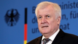 In this Monday, Nov. 5, 2018 photo German Interior Minister Horst Seehofer addresses the media during a press conference in Berlin, Germany. (AP Photo/Michael Sohn, file)