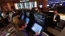 In this March 11, 2020, file photo, patrons place in person bets during the launch of legalized sports betting in Michigan at the MGM Grand Detroit casino in Detroit. (Paul Sancya/AP)