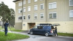 The apartment is in a nondescript building in the working-class suburb of Handen. (AFP)