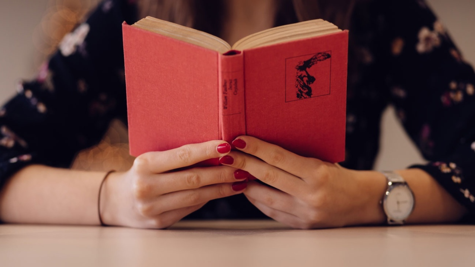 A woman is seen reading a book in this undated stock image. (Photo by freestocks.org from Pexels)