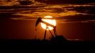 The sun sets behind an idle pump jack near Karnes City, Texas, on April 8, 2020. (Eric Gay / AP)