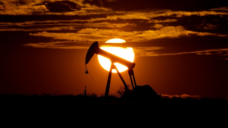 The sun sets behind an idle pump jack near Karnes City, Texas, on April 8, 2020. (Eric Gay / AP)