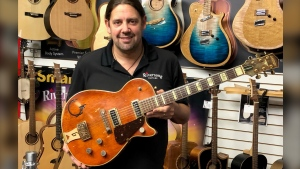 Mike Miltimore, seen in Kamloops, B.C., an undated handout photo, says the Gretsch electric guitar that a woman brought into his store is from 1955 and similar to one played by country music legend Chet Atkins before he developed his signature series of guitars. The Canadian Press/HO-Mike Miltimore