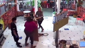 Grandma grabs table to defend family against angry