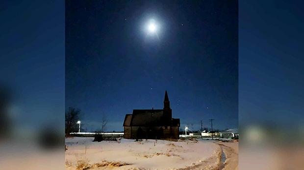 Full moon over Kinonjeoshtegon. Photo by Jennifer Traverse.