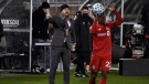 Toronto FC head coach Greg Vanney, left, calls out to his team during the first half of an MLS soccer playoff match against Nashville SC, Tuesday, Nov. 24, 2020, in East Hartford, Conn. (AP Photo/Jessica Hill)