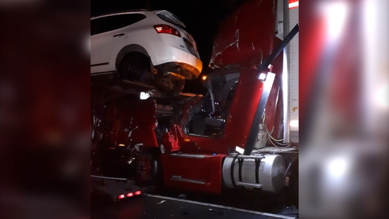 A man in his 50s was seriously injured following a collision on Highway 417 near Panmure Road early Dec. 1, 2020, after colliding with a car hauler. (Photo provided by Ottawa Fire Services)