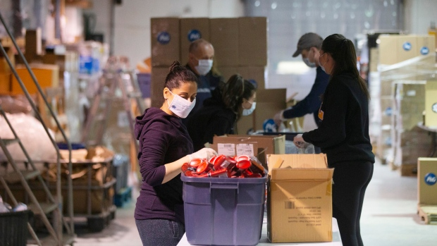Volunteers at Global Medic package sanitary supplies that are to be distributed through the Daily Bread Food Bank in Toronto on Wednesday March 18, 2020. (Chris Young/The Canadian Press)
