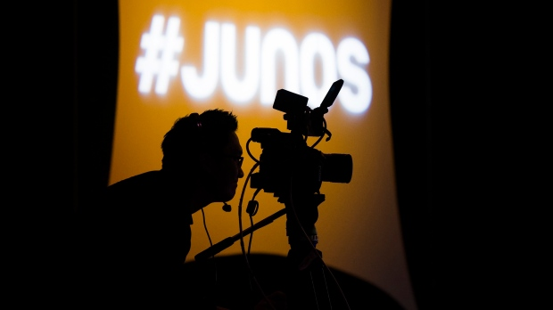 A videographer looks through his camera during the 2020 Juno Award nominee press conference in Toronto on Tuesday, January 28, 2020. THE CANADIAN PRESS/Nathan Denette