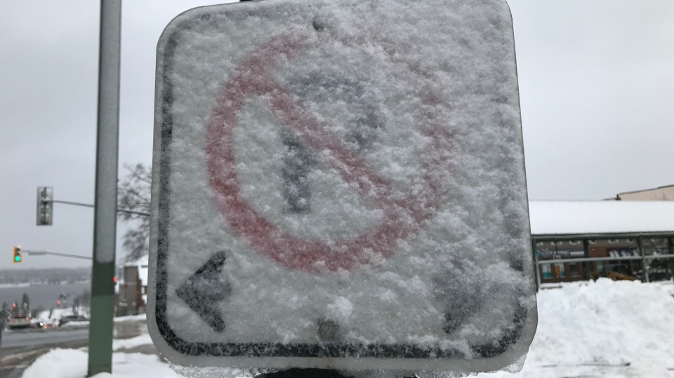 A no parking sign is covered in snow in Barrie, Ont., on Dec. 1, 2020. (Rob Cooper/CTV News)