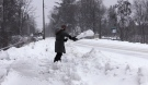 A man digs out during a snow storm in The Town of the Blue Mountains on Tues., Dec. 1, 2020. (Roger Klein/CTV News)