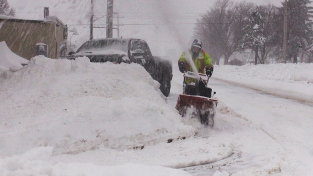 A man uses a snowblower to deal with the snowfall during a winter storm in The Town of the Blue Mountains on Tues., Dec. 1, 2020. (Roger Klein/CTV News)