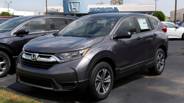 In this Tuesday, Aug. 20, 2019 photo, a Honda CR-V is shown on a dealership lot in Roseville, Mich. (AP Photo/Paul Sancya)