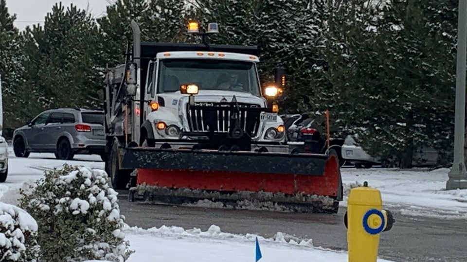 Snow plow cleans up in Windsor, Ont., on Tuesday, Dec. 1, 2020. (Rich Garton / CTV Windsor)