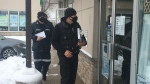 Nathan Hofstetter of Southwestern Public Health leads a team on an COVID-19 enforcement blitz of St. Thomas, Ont. businesses on Tuesday, Dec. 1, 2020. (Brent Lale / CTV News)
