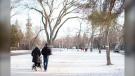 Two people walk down a path in Winnipeg, Man. on December 1, 2020. (Photo by Rosanna Hempel)