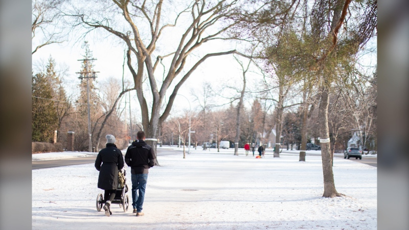 Two people walk down a path in Winnipeg, Man. on December 1, 2020. (Photo by Rosanna Hempel)