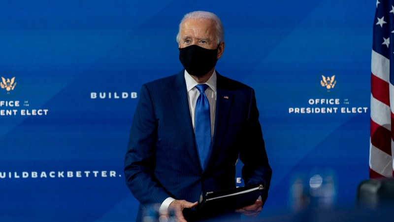 U.S. President-elect Joe Biden departs a news conference after introducing his nominees and appointees to economic policy posts at The Queen theater, Tuesday, Dec. 1, 2020, in Wilmington, Del. (AP Photo/Andrew Harnik)
