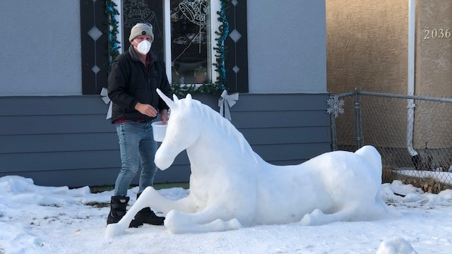 Harold Martin, who has been sculpting for 15 years, created a unicorn out of snow on Elliot Street. (CTV News)