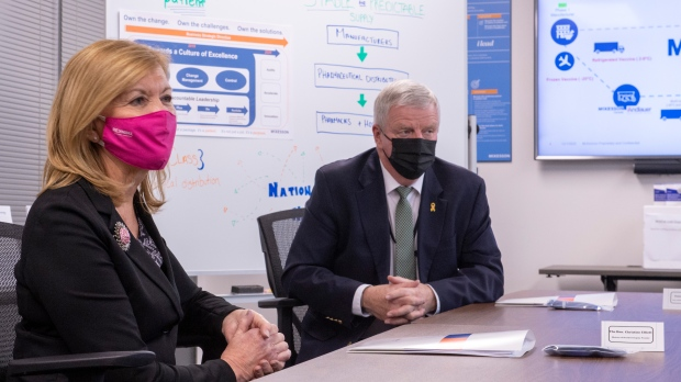 Ontario Health Minister Christine Elliott and Rick Hillier, who is overseeing the COVID-19 vaccine rollout, participate in a meeting at McKesson Canada in Toronto on Tuesday December 1, 2020. (Frank Gunn/THE CANADIAN PRESS)