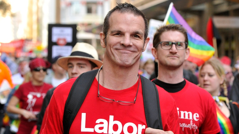 Labor Party candidate for Sydney City Council and former National Rugby League football player Ian Roberts marches in a marriage equality rally in Sydney, Aug. 13, 2016. (Joel Carrett/AAP Image via AP)