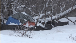 Tents along the river bank in London, Ont.