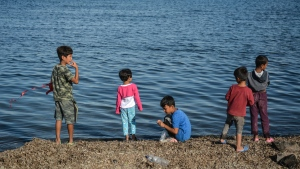 Children stand by the sea at the Kara Tepe refugee camp, on the northeastern Aegean island of Lesbos, Greece, Wednesday, Oct. 14, 2020. (AP Photo/Panagiotis Balaskas)