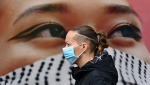 The WHO has issued new guidelines on the wearing of masks. (AFP)