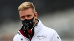 Alfa Romeo driver Mick Schumacher of Germany inspects the track prior the German Formula One Grand Prix at the Nuerburgring racetrack in Nuerburg, Germany, Thursday, Oct. 8, 2020. (AP Photo/Matthias Schrader)