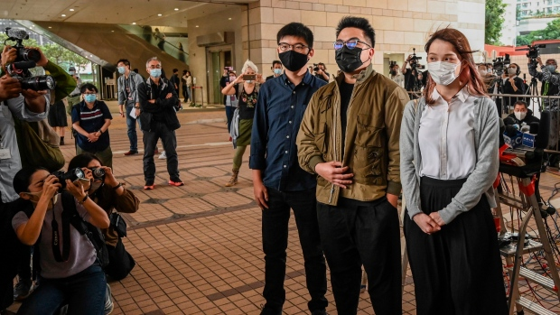 Pro-democracy activists Joshua Wong, Ivan Lam and Agnes Chow arrive for their trial at West Kowloon Magistrates Court in Hong Kong on Nov. 23. (PETER PARKS/AFP/AFP via Getty Images)