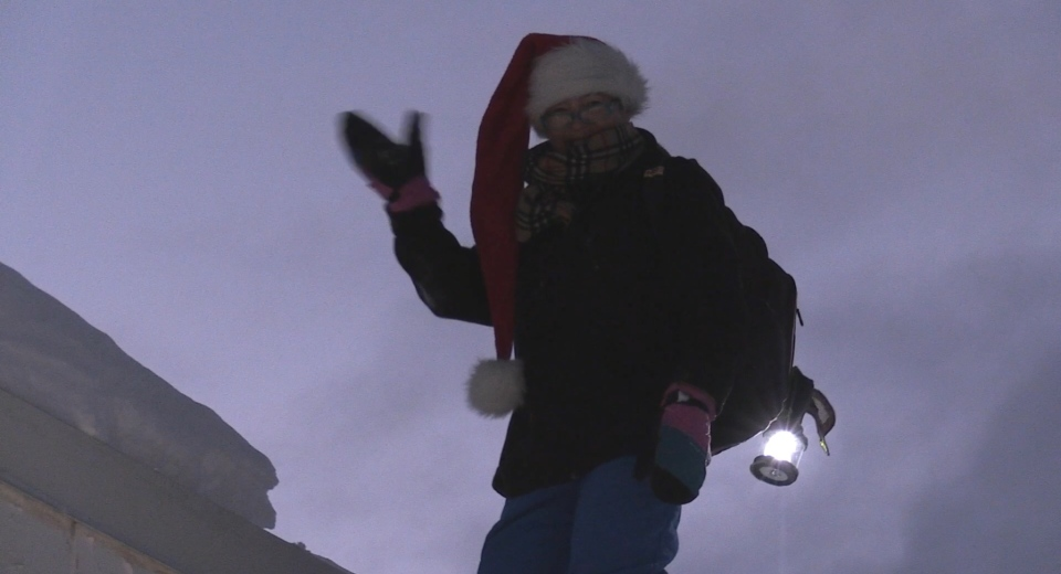 Kathie Hogan stands on the roof of Home Hardware in Powassan. Dec. 2/20 (Eric Taschner/CTV Northern Ontario)
