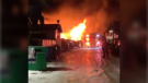 Flames pour from a detached garage along Temple Drive N.E. late Tuesday night (Twitter/@CassComber)