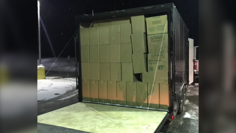 During a traffic stop on Nov. 29, 2020, OPP said officers found 12,750 cartons of unmarked cigarettes, along with an undisclosed amount of Canadian money. (Source: Ontario Provincial Police)