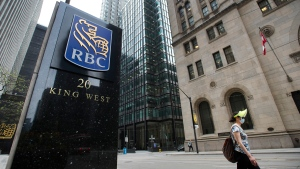 A person walks by the Royal Bank of Canada building on Bay Street during the COVID-19 pandemic in Toronto on Wednesday, May 27, 2020. (THE CANADIAN PRESS / Nathan Denette)